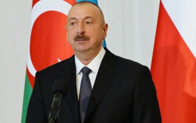 Əliyev Polşada forum açılışında
