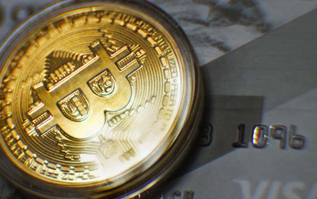 Bitkoin bir neçə saatda 18 min dollara yüksəldi