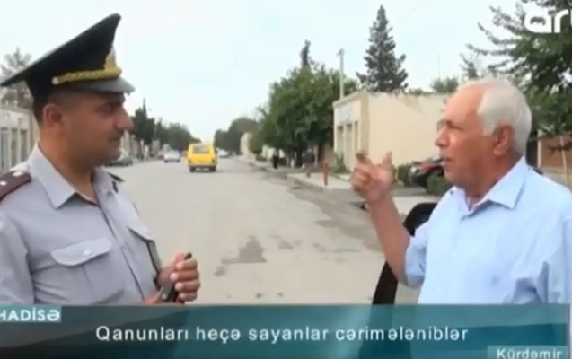 Qaydanı pozan sürücü polisə şeir dedi