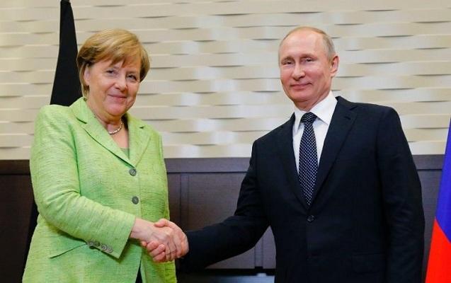 Putin Merkellə görüşdü
