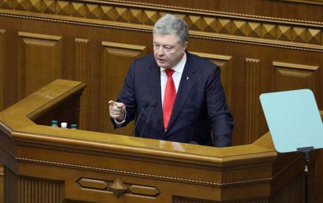 Poroşenko hərbi vəziyyət elan etməsinin səbəbini açıqladı
