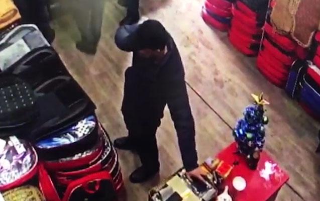 Bir oğru iki mağazada kameraya düşdü