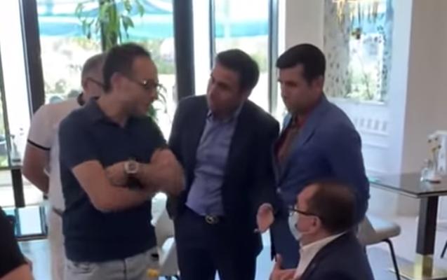 DİN maska taxmayan deputatı cərimələdi