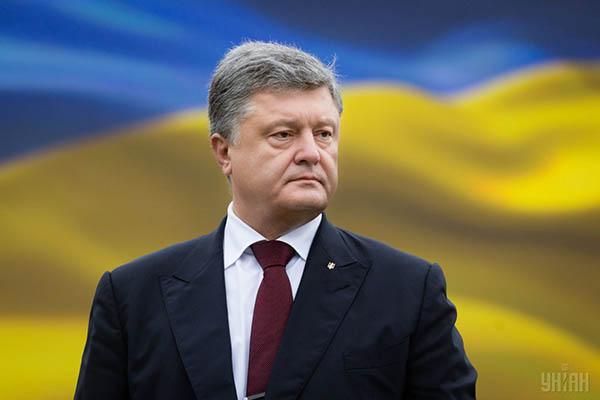 Poroşenko Donbasın reinteqrasiyası haqqında qanunu imzaladı
